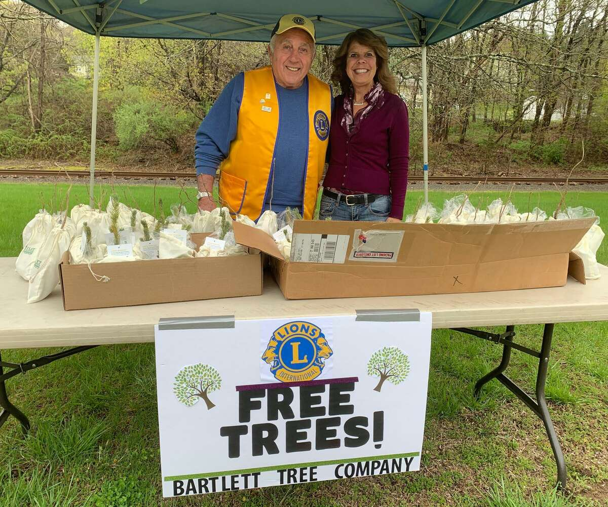 The New Milford Lions Club recently gave away 90 free trees for Arbor Day. Representatives from the Lions Club, including Lion Frank Cavielro and president Tammy Deak, were on hand at Harrybrooke Park to give residents the trees. Ninety trees - chosen in recognition of the club's 90th anniversary this year - were donated by Bartlett Tree Experts.