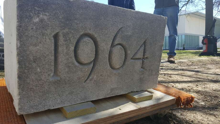 Workers from University at Albany's facilities department excavated a time capsule from a corner of Dutch Quad on May 7, 2019, in Albany, N.Y. The time capsule was placed there by students in 1964 and was re-opened the school's 175th anniversary celebration. Photo: University At Albany Digital Media