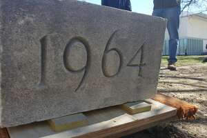 Workers from University at Albany's facilities department excavated a time capsule from a corner of Dutch Quad on May 7, 2019, in Albany, N.Y. The time capsule was placed there by students in 1964 and was re-opened the school's 175th anniversary celebration.