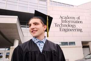 Virginia Tech-bound Dylan Martin, 17, during his Academy of Information Technology & Engineering Commencement at the school in Stamford, Conn., Friday, June 22, 2018.