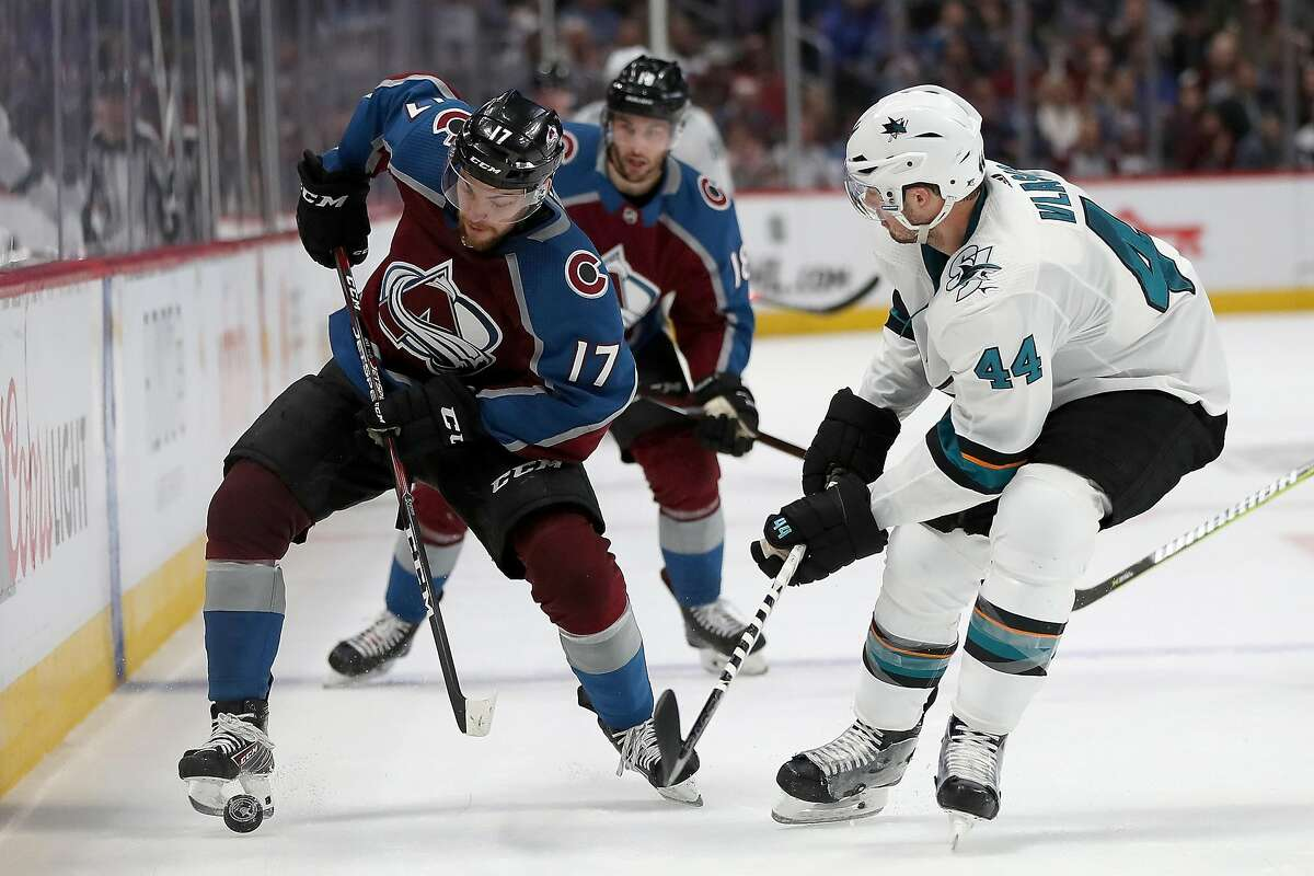 DENVER, COLORADO - MAY 06: Tyson Jost #17 of the Colorado Avalanche advances the puck against Marc-Edouard Vlasic #44 of the San Jose Sharks in the second period during Game Six of the Western Conference Second Round during the 2019 NHL Stanley Cup Playoffs at the Pepsi Center on May 6, 2019 in Denver, Colorado. (Photo by Matthew Stockman/Getty Images)