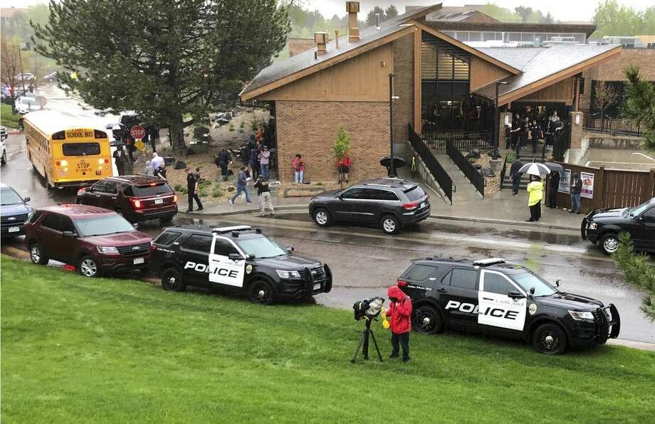 Police and others are seen outside STEM School Highlands Ranch, a charter middle school in the Denver suburb of Highlands Ranch, Colo., after a shooting Tuesday, May 7, 2019. Authorities said several people were injured and a few suspects were in custody. (AP Photo/David Zalubowski) Photo: David Zalubowski/AP
