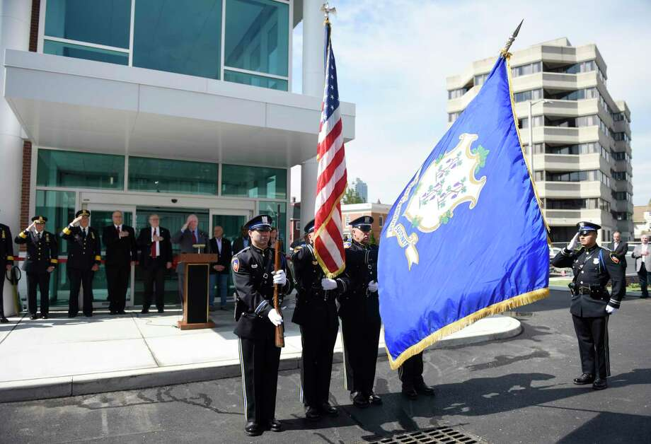 The Stamford Police Honor Guard presents the colors before the ribbon-cutting at the new Stamford Police headquarters on Tuesday. The new 94,000-square-foot station sits on the corner of Bedford and North streets, just south of the current police headquarters, which will be demolished after the move-in is complete. Photo: Tyler Sizemore / Hearst Connecticut Media / Greenwich Time