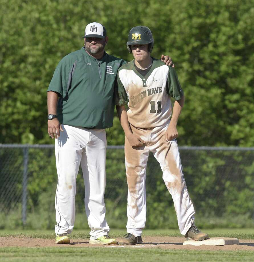 New Milford coach Ryan Johnson talks with Luke Pliego after he reached third in a March 29, 2018, game against Greenwich in New Milford. Photo: H John Voorhees III / Hearst Connecticut Media / The News-Times