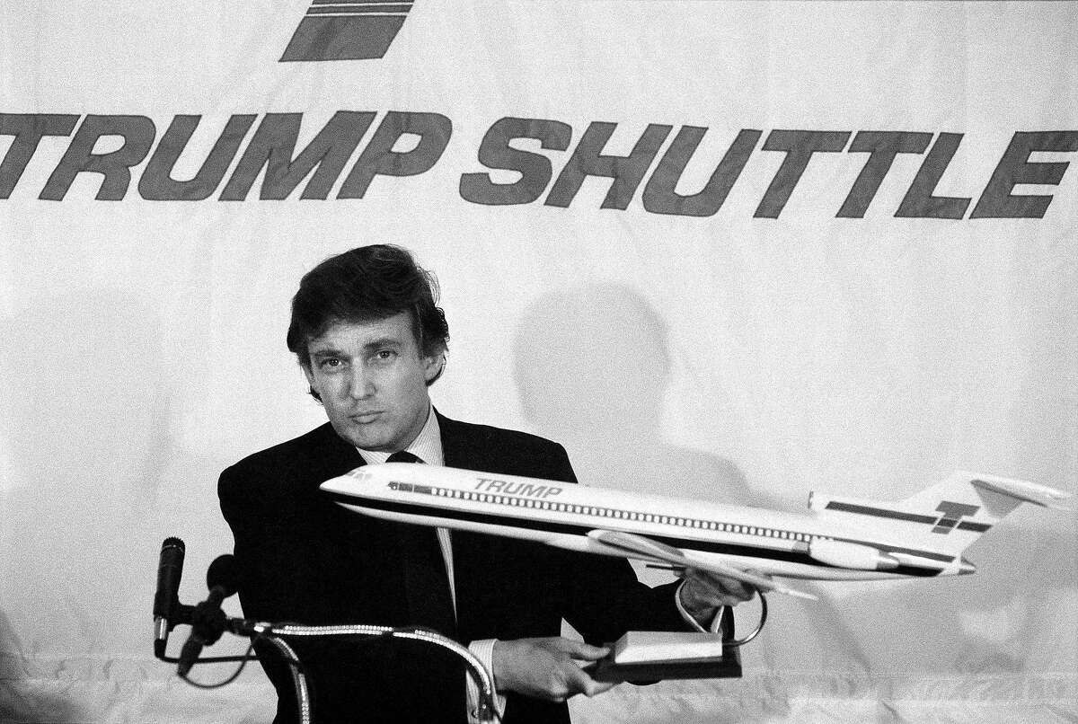 FILE - Donald Trump announces his airline venture, the Trump Shuttle, in Manhattan, June 7, 1989. Printouts obtained by The New York Times from Trump's official Internal Revenue Service tax transcripts, including figures from his federal tax form for the years 1985 to 1994, reveal that Trump's businesses were in far bleaker condition at that time than was previously known. (Don Hogan Charles/The New York Times)
