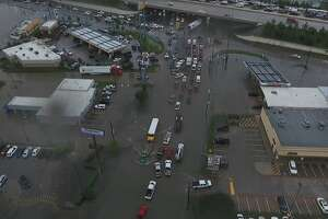 Drone footage shows flooding at FM 1485 and U.S. 59 in New Caney.