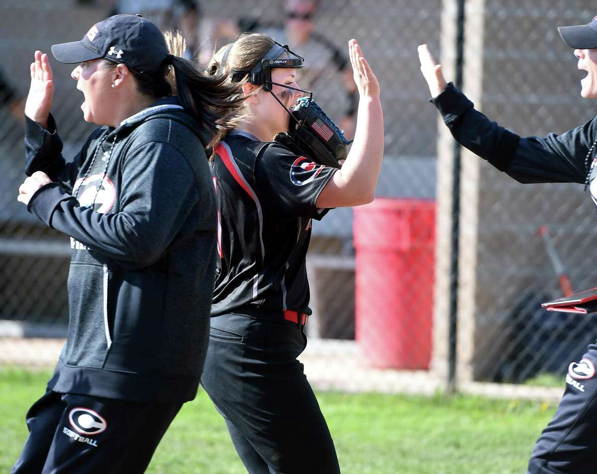 Cheshire's Bri Pearson is congratulated by coaches in the fourth inning on her way to a no-hitter against Amity on Tuesday.