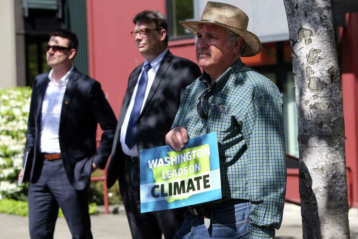 Washington State Governor Jay Inslee signs five climate change bills into law that will reduce carbon emissions, decrease pollution, boost jobs and increase public health, Tuesday, May 7, 2019, at Central Park in the Rainier Vista neighborhood. The bills include SB 5116, HB 1112, HB 1257, HB 1444, HB 2042.