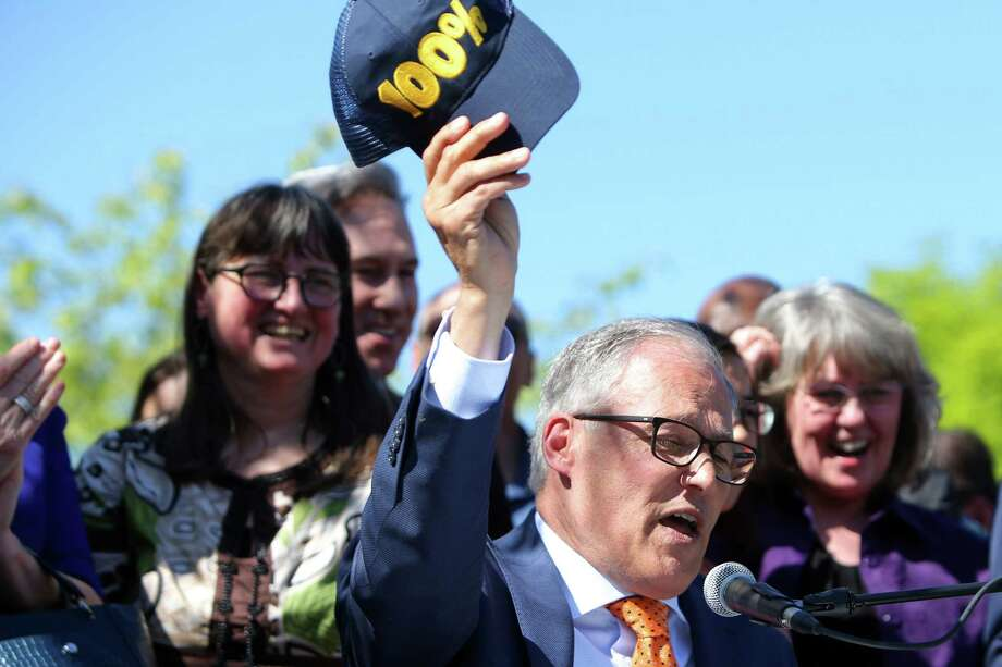Washington State Governor and presidental candidate Jay Inslee signs five climate change bills into law that will reduce carbon emissions, decrease pollution, boost jobs and increase public health, Tuesday, May 7, 2019, at Central Park in the Rainier Vista neighborhood. The bills include SB 5116, HB 1112, HB 1257, HB 1444, HB 2042. Photo: Genna Martin, SEATTLEPI / GENNA MARTIN