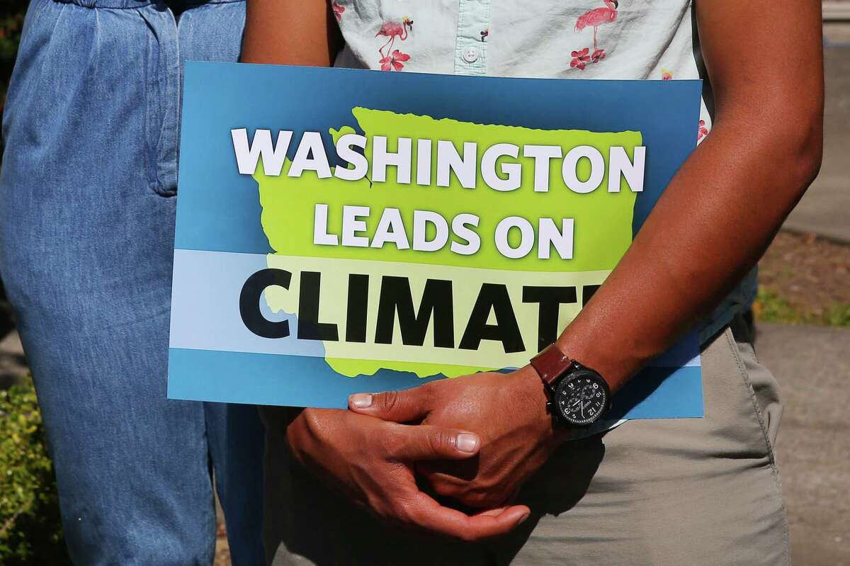 Washington State Governor and presidental candidate Jay Inslee signs five climate change bills into law that will reduce carbon emissions, decrease pollution, boost jobs and increase public health, Tuesday, May 7, 2019, at Central Park in the Rainier Vista neighborhood.