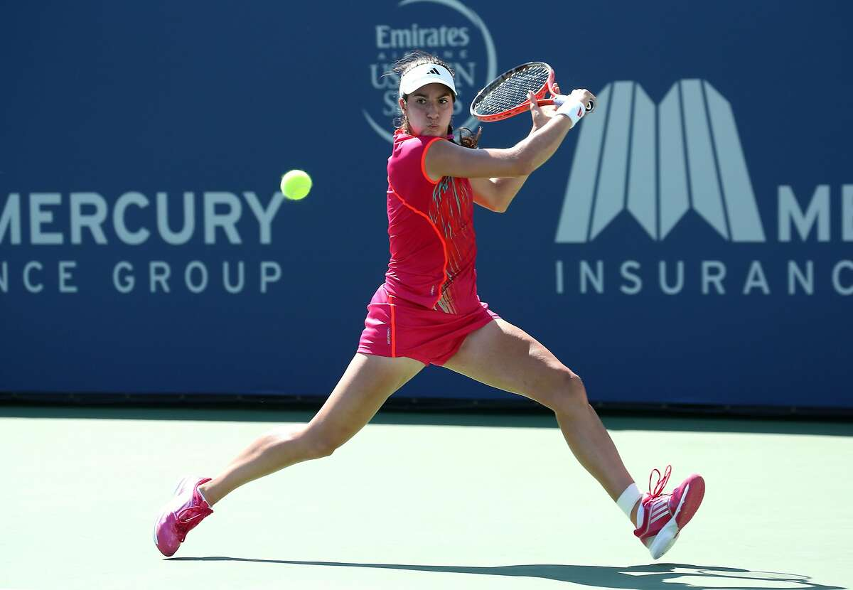 CARLSBAD, CA - JULY 17: Christina McHale returns to Jarmila Gajdosova of Australia during the Mercury Insurance Open Presented By Tri-City Medical at La Costa Resort & Spa on July 17, 2012 in Carlsbad, California. McHale won 7-6 (5), 7-5. (Photo by Stephen Dunn/Getty Images)