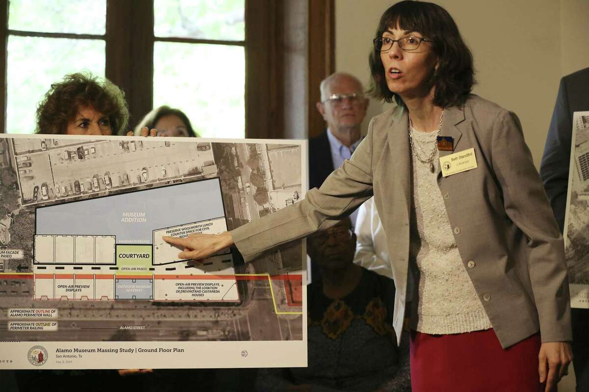 Beth Standifird, librarian with the San Antonio Conservation Society, points to a spot on a rendering which is believed to have been the location of the Woolworth's lunch counter as officials with the San Antonio Conservation Society unveil a