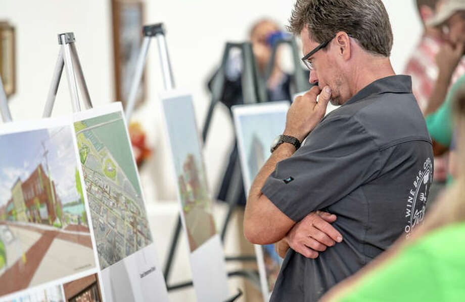 Glenn Beaubien, co-owner of State Street Market of Alton, studies downtown revitalization plans unveiled Tuesday by John and Jayne Simmons at Jacoby Arts Center. Photo: Nathan Woodside | The Telegraph