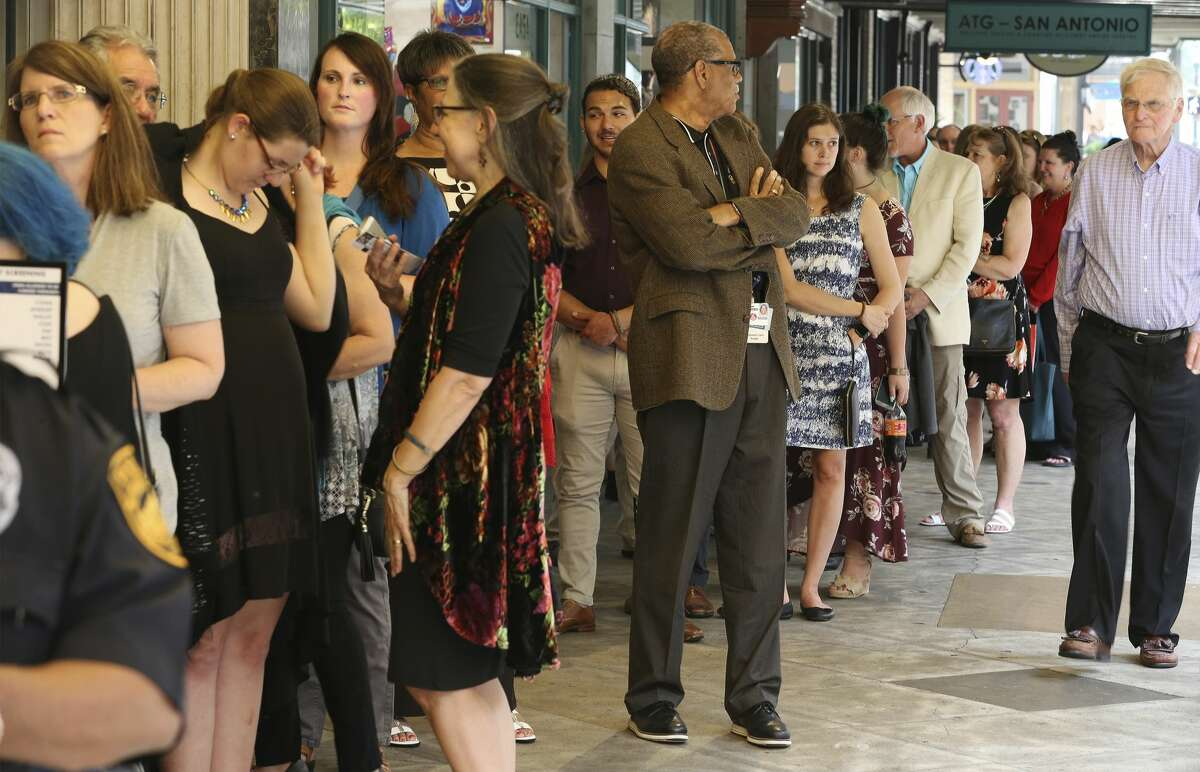A long line of show-goers await to go into the Majestic Theater for the premier showing of