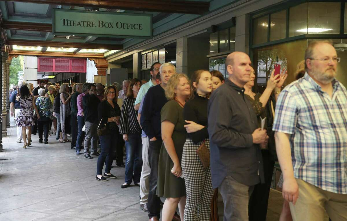 A long line of show-goers makes their way into the Majestic Theater for the opening of the show