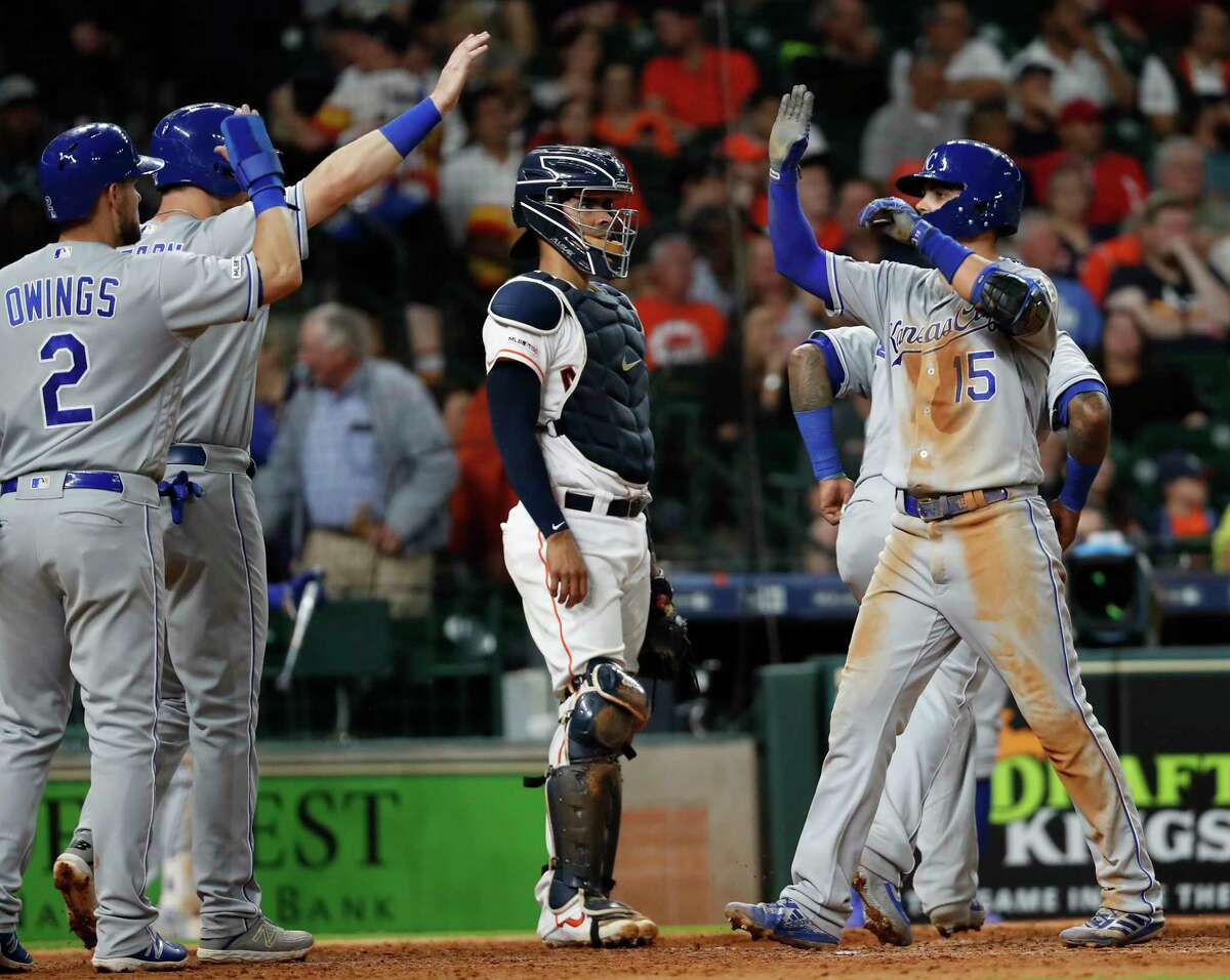 Kansas City Royals Whit Merrifield (15) celebrates his grand slam home run off Houston Astros relief pitcher Framber Valdez (59) during the seventh inning of a major league baseball game at Minute Maid Park on Tuesday, May 7, 2019, in Houston.