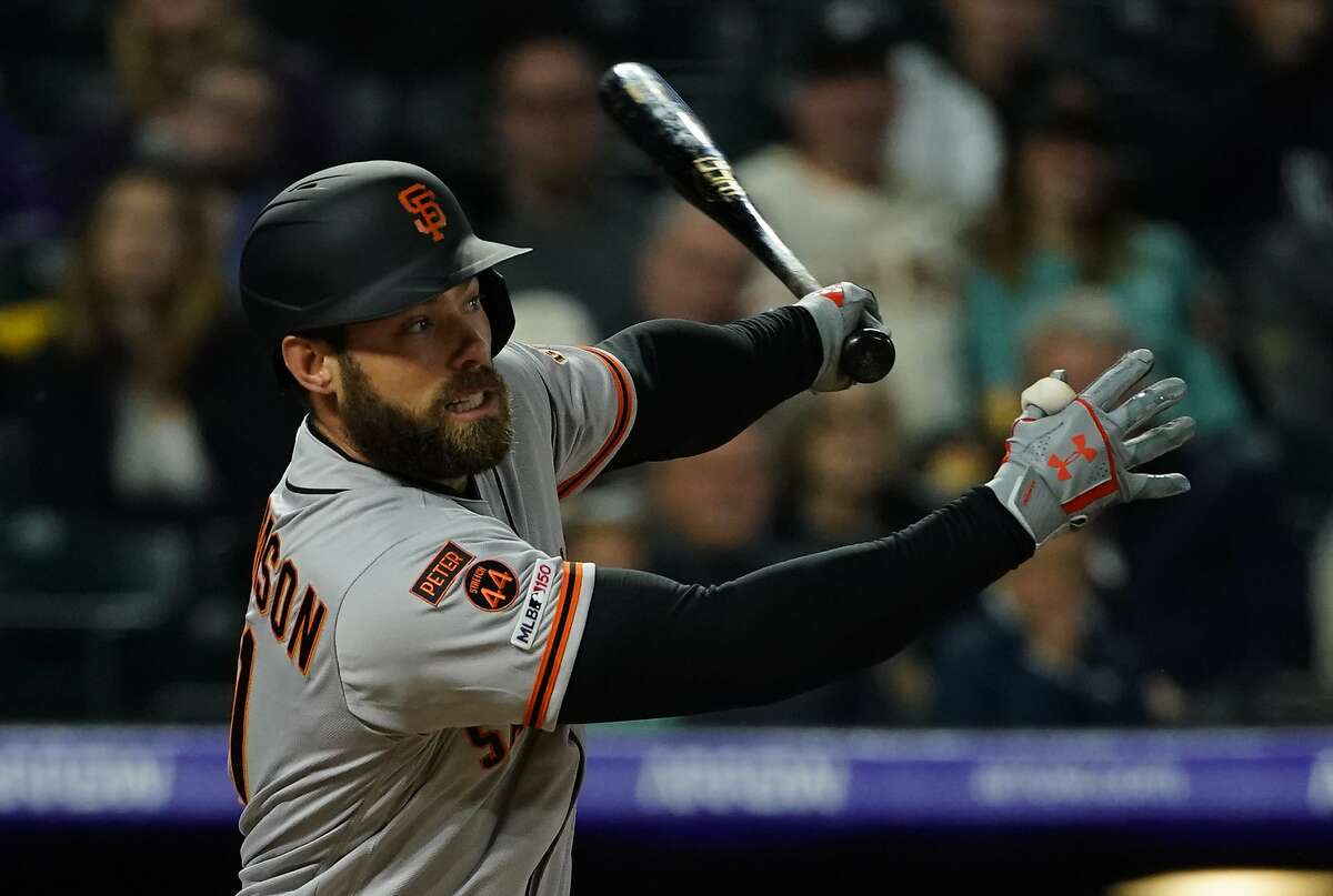 San Francisco Giants' Mac Williamson watches the flight of an RBI single all hit against the Colorado Rockies during the fifth inning of an MLB baseball game Tuesday, May 7, 2019, in Denver. (AP Photo/Jack Dempsey)