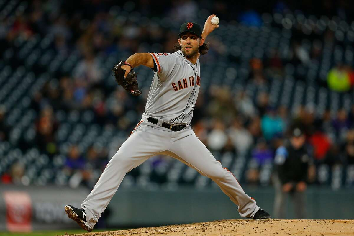 FILE - Starting pitcher Madison Bumgarner #40 of the San Francisco Giants delivers to home plate during the fourth inning against the Colorado Rockies at Coors Field in this May 7, 2019 file photo taken in Denver, Colorado. Bumgarner has reportedly released his no-trade list to the Giants', but it doesn't include the franchise's rival, the Los Angeles Dodgers.