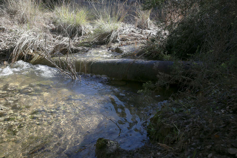 A remnant of an old pipeline is seen running through a creek that feeds into the Pedernales River on the historic Hershey Ranch in Stonewall on Thursday, Dec. 27, 2018. Property Manager Andy Sansom is concerned about the environmental impact of a new pipeline which will carry natural gas and that will run through the property. Kinder Morgan wants to build a 42-inch natural gas pipeline south of Fredericksburg, Texas and that has alarmed land owners, small and large, that a large, 42-inch diameter natural gas pipeline will intrude onto their properties. Photo: Kin Man Hui/San Antonio Express-News