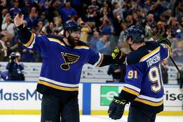 St. Louis Blues left wing Pat Maroon (7) and right wing Vladimir Tarasenko (91) celebrate the team's 2-1 win against the Dallas Stars in two overtimes in Game 7 of an NHL second-round hockey playoff series on Tuesday, May 7, 2019, in St. Louis. (AP Photo/Jeff Roberson)