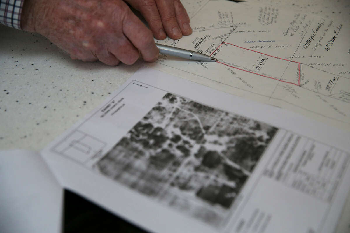 Property Owner Henry Sauer shows on a drawing where a pipeline may cross through his property on Thursday, Dec. 27, 2018. Kinder Morgan wants to build a 42-inch natural gas pipeline south of Fredericksburg, Texas and that has alarmed land owners, like Sauer, that a large, 42-inch diameter natural gas pipeline will intrude onto their properties. The impending construction of the pipeline on their land have some concerned about the environmental impact that will have in the surrounding area.