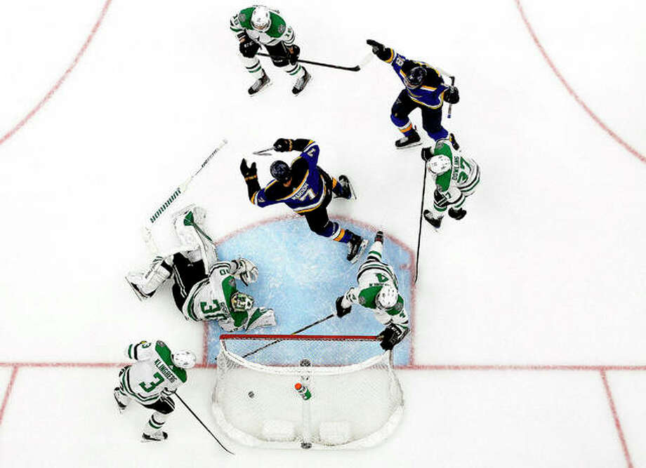 The Blues' Pat Maroon (7) and Robert Thomas (18) celebrate Maroon's game-winning game in double overtime, as Dallas Stars' John Klingberg (3), Ben Bishop (30), Miro Heiskanen (4) and Justin Dowling (37) in Tuesday night's Game 7 of their Stanley Cup Playoff series in St. Louis. Photo: Jeff Roberson | AP Photo
