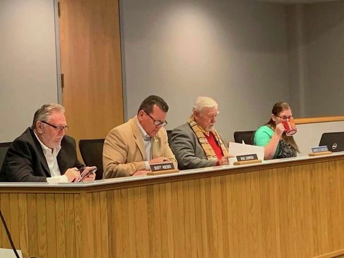 Left to right, commissioners Scott Noesen,Eric Dorrien, James Geisler and administrative assistant Jessica Gilkins attend to Midland County Board of Commissioners business at a regular meeting on May 7, 2019.