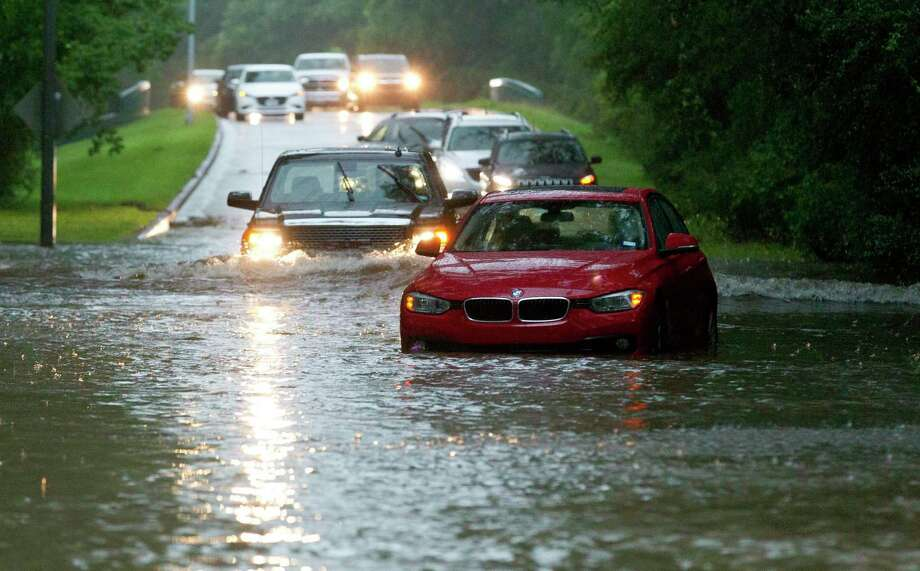 Vehicles wade through flooded Kingwood Drive as thunderstorms hit the Kingwood area Tuesday, May 7, 2019, in Kingwood, Texas. Heavy rain is battering parts of southeast Texas prompting flash flood warnings, power outages and calls for water rescues. (Jason Fochtman/Houston Chronicle via AP) Photo: Jason Fochtman, MBO / Associated Press / © 2019 Houston Chronicle