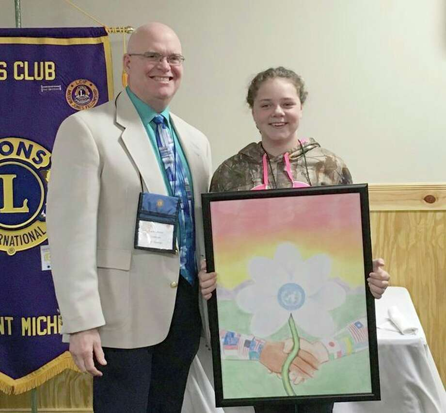 Harley Lattimer, right, recently placed first in the Lions Clubs International annual Peace Poster contest for students ages 11 to 13. With her is art teacher Lane Dexter. (Photo provided/Coleman Lions Club)