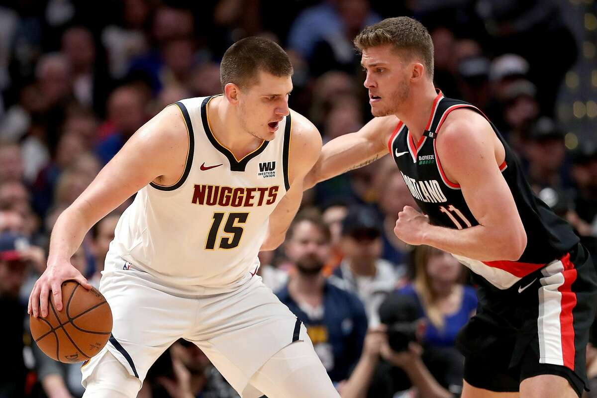 DENVER, COLORADO - MAY 07: Nikola Jokic #15 of the Denver Nuggets is is guarded by Meyers Leonard #11 of the Portland Trail Blazers after a flagrant foul in the fourth quarter during Game Five of the Western Conference Semi-Finals of the 2019 NBA Playoffs at the Pepsi Center on May 7, 2019 in Denver, Colorado. NOTE TO USER: User expressly acknowledges and agrees that, by downloading and or using this photograph, User is consenting to the terms and conditions of the Getty Images License Agreement.(Photo by Matthew Stockman/Getty Images)