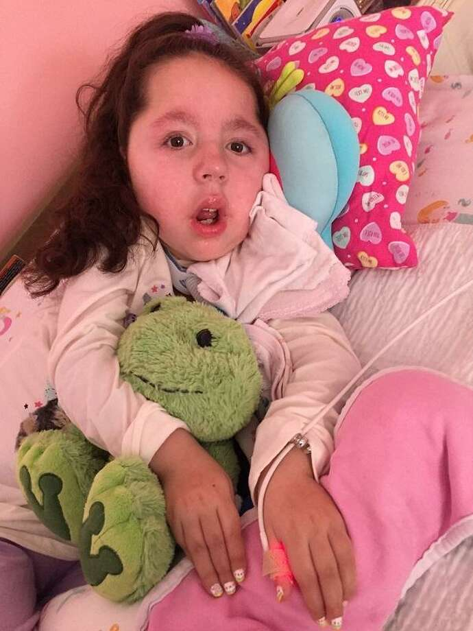 Eva Grace Kelly, 8, of West Haven, is on life support due to a degenerative muscle disorder, but her family works hard to give her as much of a normal life as possible. Photo: Pam McLoughlin / Hearst Connecticut Media