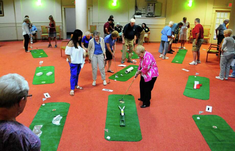 Residents participate in the annual mini golf tournament in 2017 at the Springs at Watermark 3030 Park in Bridgeport. The state recently fined the facility $6,960 after a resident fell onto the floor when being moved from a bed to a wheelchair by two nurse aides. Photo: Christian Abraham / Hearst Connecticut Media / Connecticut Post