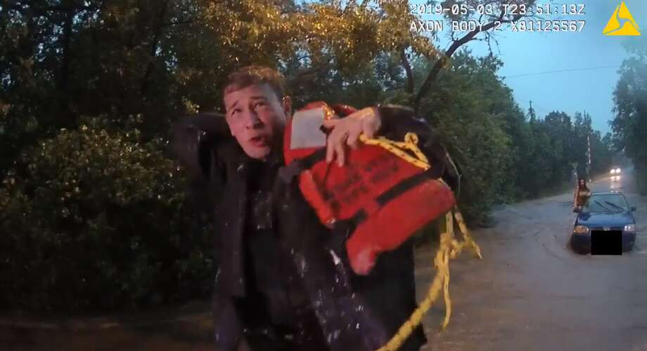 Austin police on Wednesday released dramatic body camera footage of officers saving three women and a dog from rushing floodwaters last week. Photo: Austin Police Department
