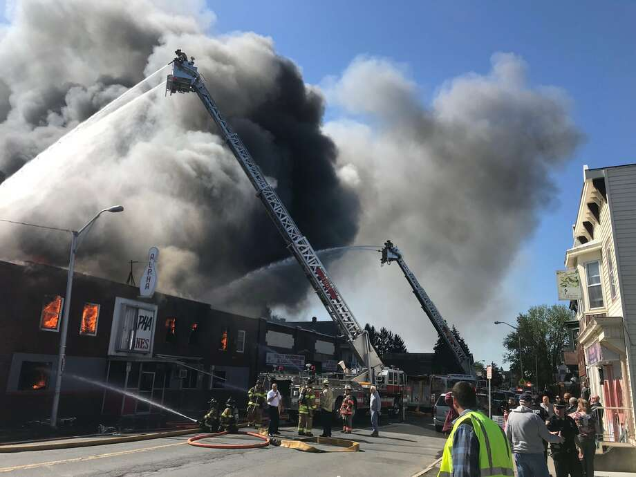 Firefighters battle a stubborn fire Wednesday morning at the Alpha Lanes bowling alley at 326 Fifth Ave., in the Lansingburgh neighborhood. Photo: Kenneth C. Crowe II / Times Union