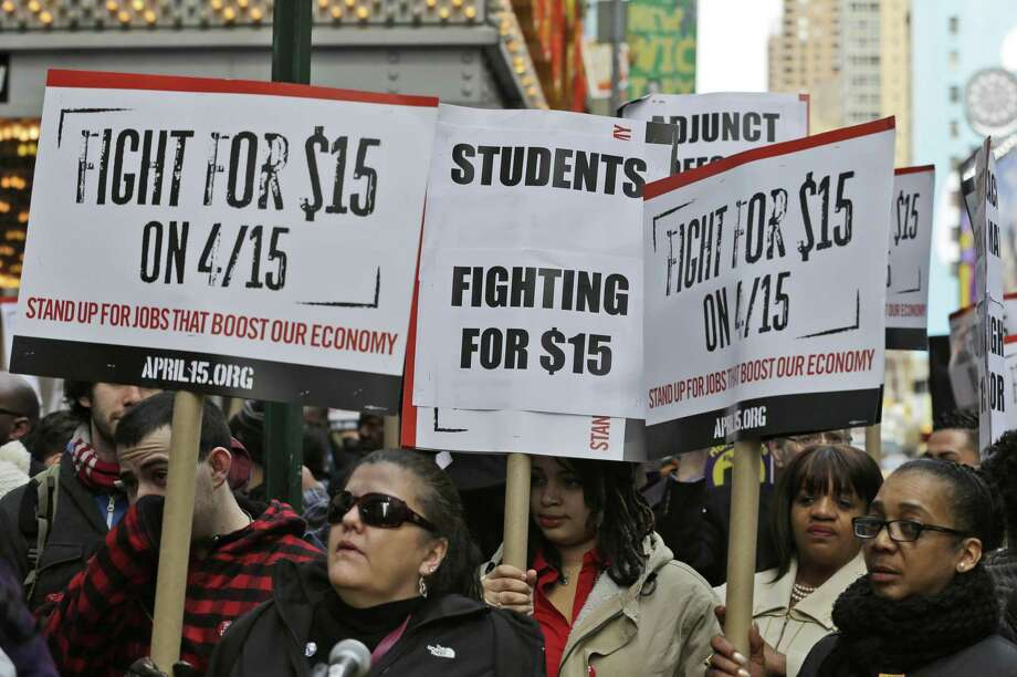 In a 2015 file photo, fast-food labor organizers stages protests in New York over the $15 minimum wage. Photo: Seth Wenig / Associated Press / AP
