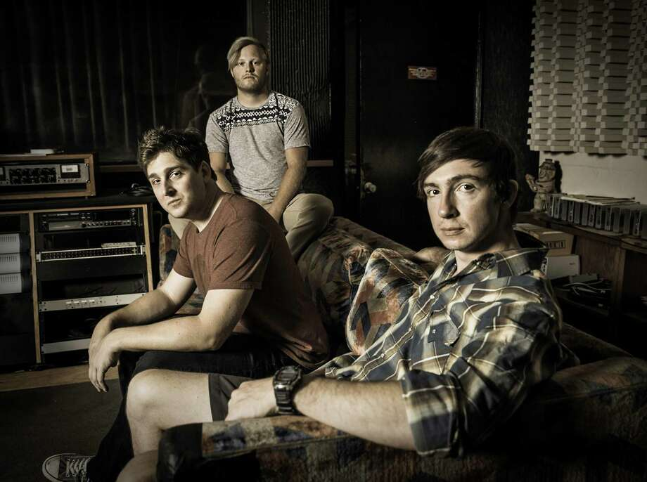Original members of the group Field of Bronze from left Joshua Pitt, Jonathan Hoffman and Bobby Westmoreland at Sugar Hill Studios in Houston. Photo: Courtesy Photo