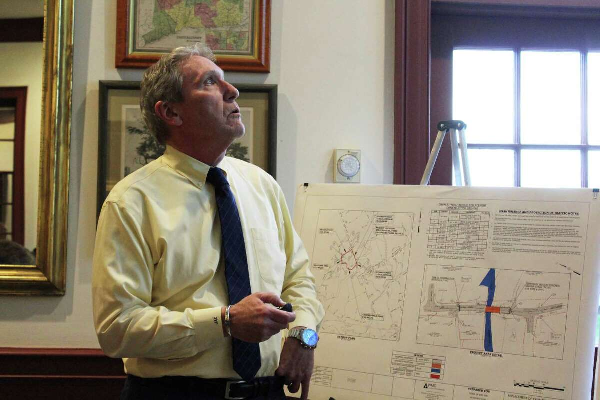 Jay Costello of Wengell, McDonnell & Costello, Inc., shows attendees where the company will be placing slopes in the Cavalry Road Bridge area during a meeting at Weston Town Hall on May 7, 2019.