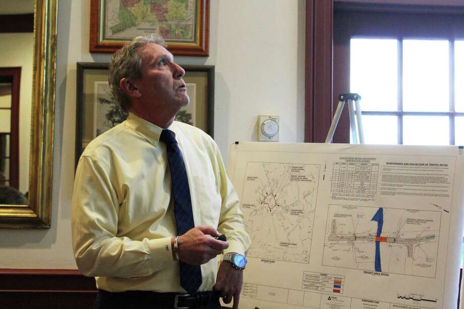 Jay Costello of Wengell, McDonnell & Costello, Inc., shows attendees where the company will be placing slopes in the Cavalry Road Bridge area during a meeting at Weston Town Hall on May 7, 2019. Photo: Melanie Espinal / For Hearst Connecticut Media