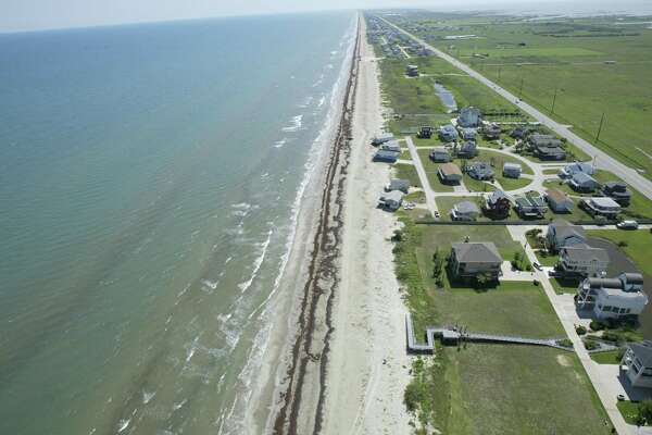 Jamaica Beach, shown in this June 2, 2005 aerial, is not protected by Galveston's seawall. The Texas Department of Transportation plans to elevate FM 3005 to keep it above some high tides.