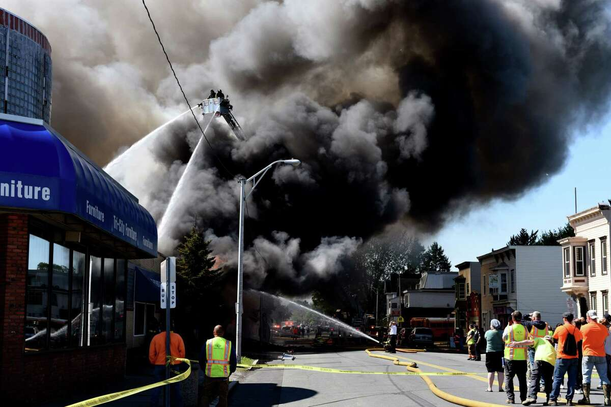 Firefighters battle a massive blaze on 5th Avenue that consumed the Alpha Lanes bowling alley on Wednesday, May 8, 2019, in Troy, N.Y. (Will Waldron/Times Union)