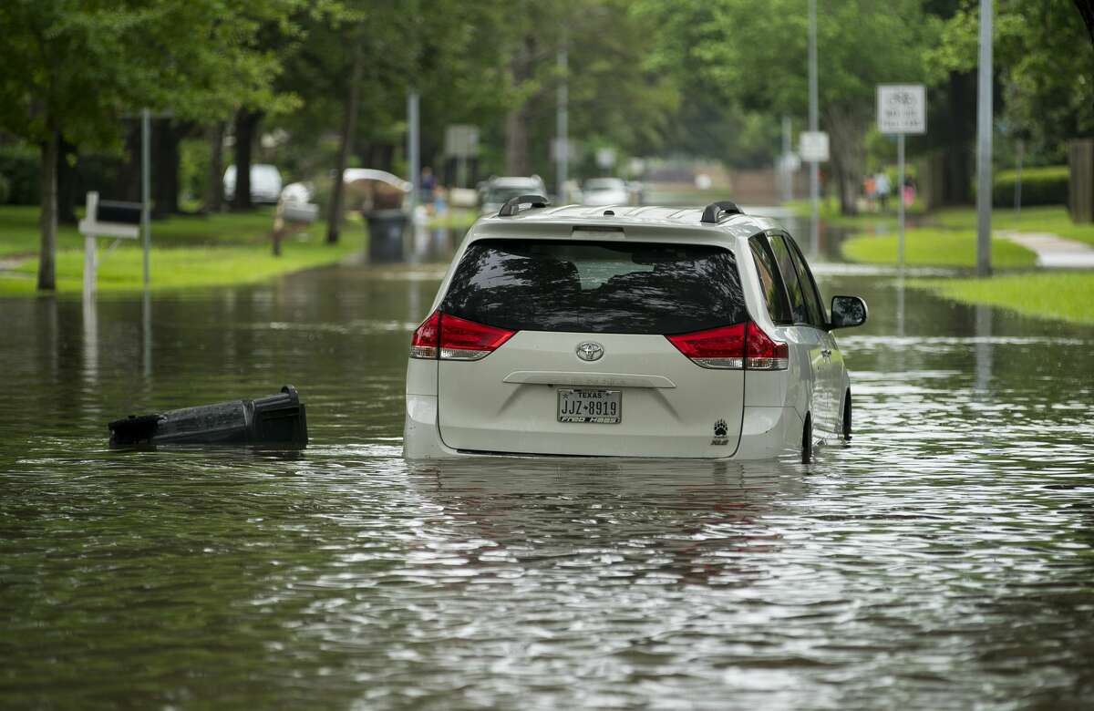 A car sits stuck in the street in the Colony Bend neighborhood of Sugar Land, Wednesday, May 8, 2019. Residents have been surprised that the water has not receded more quickly as it has in the past when the rain has stopped. In a video released Wednesday morning, the mayor of Sugar Land told residents that levees to the Brazos River had been closed, and that water was now being pumped over the levees into the Brazos, making the water recede much more slowly. More rain is forecast for the coming days.