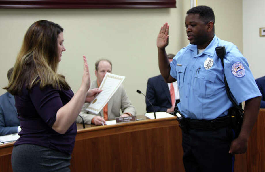 Edwardsville City Clerk Jeannie Wojcieszak, left, administers the oath of office Monday to new Edwardsville Police Department Officer Silas Ellis, who is an Edwardsville resident. Photo: Charles Bolinger | The Intelligencer