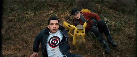 """Kathryn Newton and Justice Smith in """"Pokemon Detective Pikachu."""" (Warner Bros. Pictures)"""