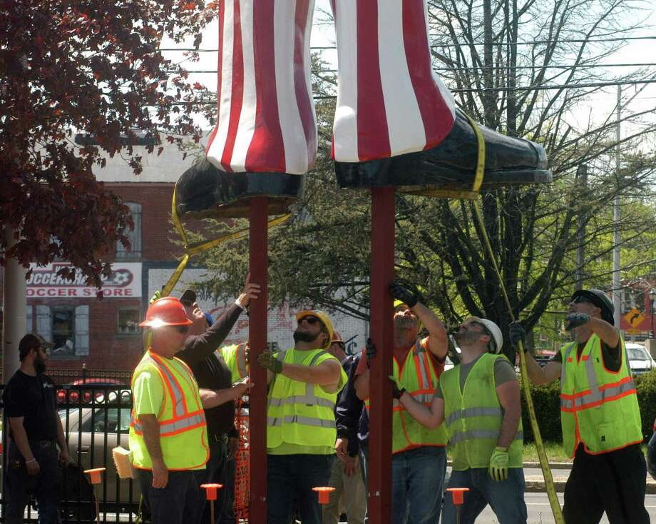 Workers installing Uncle Sam outside the Danbury Railway Museum on White Street on Wednesday, May 8, 2019. Photo: Rob Ryser / Hearst Connecticut Media