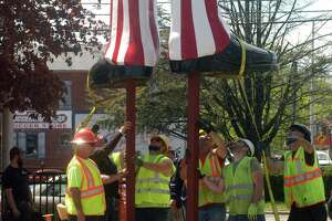 Workers installing Uncle Sam outside the Danbury Railway Museum on White Street on Wednesday, May 8, 2019.