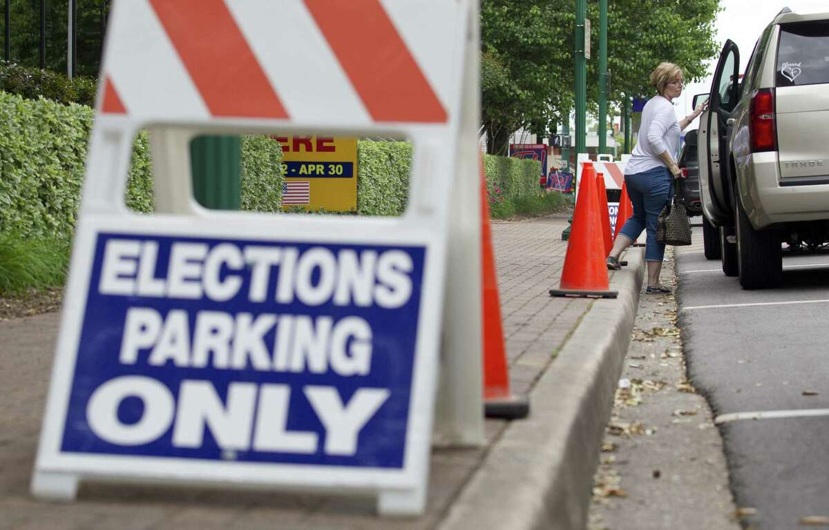 A woman uses elections parking to pull up in front of Lee G. Alworth Building as municipal voting continues, Tuesday, April 23, 2019, in Conroe. Election Day is May 4. Only 15,230 votes were cast in total for the Conroe ISD bond proposition, and nearly 54.5% of those votes were against the bond.