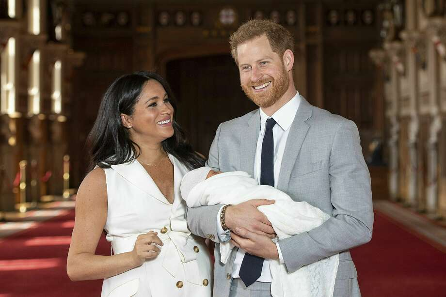 "Britain's Prince Harry and Meghan, Duchess of Sussex, during a photocall with their newborn son, in St George's Hall at Windsor Castle, Windsor, south England, Wednesday May 8, 2019. Baby Sussex was born Monday at 5:26 a.m. (0426 GMT; 12:26 a.m. EDT) at an as-yet-undisclosed location. An overjoyed Harry said he and Meghan are ""thinking"" about names. (Dominic Lipinski/Pool via AP) Photo: Dominic Lipinski / Associated Press"