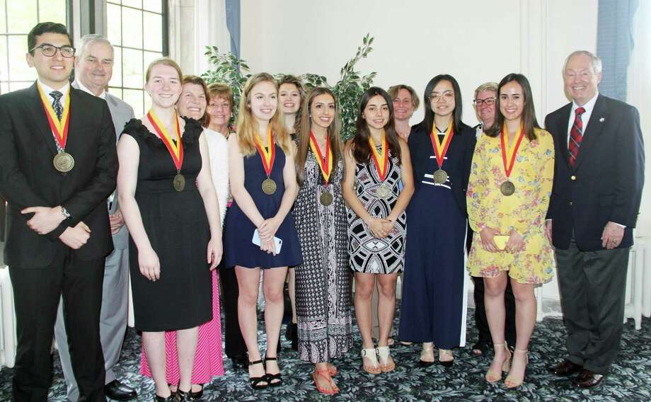 East Catholic High School student and Middletown resident Irene Soteriou, eighth from left (in the black paisley dress), was recently honored as a Summa Scholar. Photo: Contributed Photo
