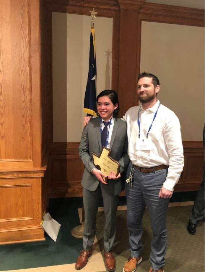 The Woodlands High School Senior Agustin Perez is Texas' Citizen Bee champion. Perez just became a United States citizen last year. Here, he poses with his award. Photo: Submitted Photo / Submitted Photo