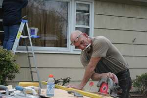 Carpenter Mike Deleen was part of a team of volunteers from First Congregational Church of Ridgefield that spent the day fixing up the home of a single mother in Danbury on May 4. The volunteers were working as part of the 32nd annual HomeFront Day.